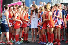 Kate Middleton talks to members of Team Great Britain's field hockey team after their bronze medal match against New Zealand on Day 14.