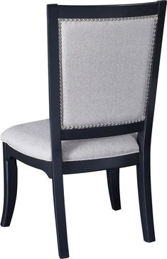 Manuscript Side Chair   Round out your Manuscript dining room with the collection's Arm and Side Chairs. Upholstered front and back, these chairs feature the same chrome nail head detail as found on the  standard bed panels.