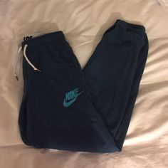 Nike teal sweatpants Super comfy and in amazing condition! Nike Pants Track Pants & Joggers