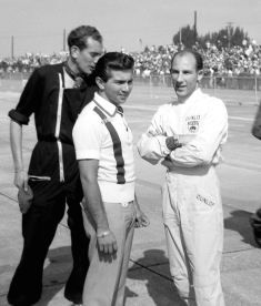 1960-Ricardo Rodriguez and Stirling Moss prior to the start of the race. Ricardo and brother Pedro would team up driving a NART Ferrari Dino 196S. BARC boys photo.