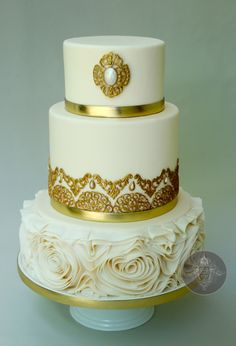 Golden Wedding Cake with Floral ruffles  - This is a gold themed  wedding cake for a golden anniversary!
