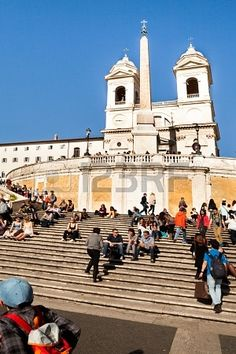 ROME, ITALY - APRIL 11: Beginnings of touristic season in Rome with the beautiful sunny days of April. People enjoying the sun on the Spanish Steps - April 11, 2013, in Rome. Stock Photo - 19997326