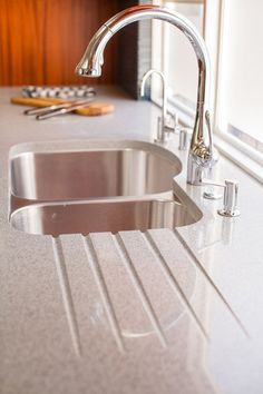 Recycled Glass and Cement countertops - cool. CLEVER: grooves for water drainage from a drying rack.
