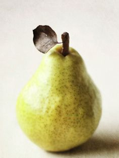 Green pear with freckles.