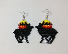 These Elk Beaded Earrings are made with glass Delica beads in a Peyote Stitch. With silver french hooks. These earrings are 3 long and 1 wide.