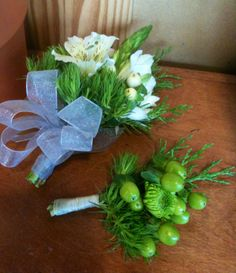 Green and white boutonniere and corsage made at Greenlife Grocery in Asheville - Hypericum berries, green ball dianthus, button mums, alstromeria, star of bethlehem, evergreen