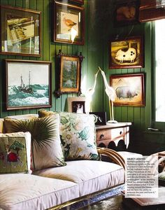 Elegant Rattan Furniture....Green paneled walls mixed with various curiosities make this look like the perfect place to curl up with a good book. I especially like the cranes perched on the side table.