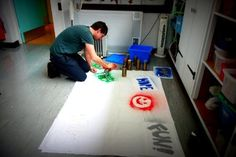 Graffitti Workshop, part of Open Week. Stencils & paint on cotton sheeting. http://www.headway-cambs.org.uk/