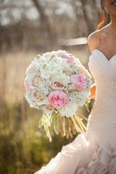 Bridal Bouquet-You have pink and babys breath in your bouquet and since the bridesmaid dresses will be pink we could do a babys breath bouquet.