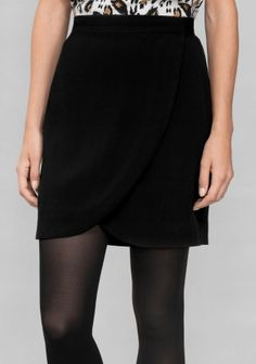 & OTHER STORIES This versatile everyday wrap skirt features a wide waistband and an asymmetric hemline.