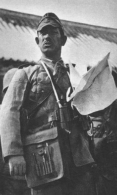 Japanese navy officer of the Special Naval Landing Force (海軍特別陸戦隊) holding a map during combat operations around south China,1939