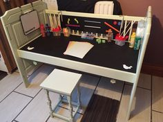 Cot converted into an activity desk