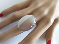 This is a beautiful unique handcrafted Sterling and Agate stone ring with an unusual color combination. The stone has been handset in a bezel with a Sterling back plate, soldered to a chunky Sterling Silver band. The Agate has two definite colors with an unseen line dividing between them of Beige Black And White Rings, Agate Jewelry, Agate Ring, Handmade Rings, Handmade Jewelry Designs, Agate Stone, Unique Rings, Triangle Earrings, Jewerly