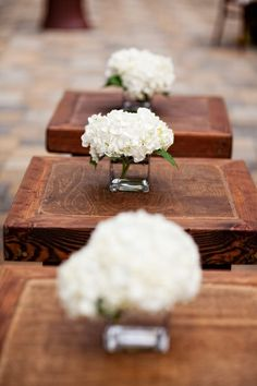 white hydrangeas.  I have a bunch of small/medium size glass square vases that we could use for a super easy and inexpensive centerpiece for our smaller tables...
