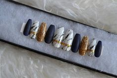 Matte Navy blue and marble nails with gold accents. These sleek and stunning nails make the perfect addition to anyones collection! (This set is made with all cruelty-free materials) Available in all shapes. Available in all sizes and as a full set of 24 nails in all sizes. If you do