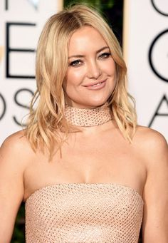 Before styling Kate Hudson's hair for the Golden Globes celeb stylist David Babaii pulled out his scissors! After chopping it into a long bob, Babaii used the GHD Platinum White Styler Flat Iron around random sections to create a wavy texture. Click for more great red carpet hair and beauty how-tos!