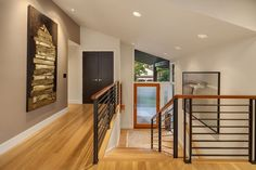 Contemporary Entryway with Hardwood floors, High ceiling, Metal stair railing, Entry, Carpet