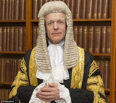 High Court Judge, Lord Justice Fulford - dressed in full legal regalia. Campaigned to support paedophile group 'PIE', who openly called to legalise sex with children and lower the age of consent to just four.