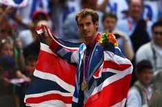 olympics:    Gold medalist Andy Murray of Great Britain poses during the medal ceremony for the Men's Singles Tennis match. Murray defeated Federer in the gold medal match in straight sets 2-6, 1-6, 4-6.     Photo by Paul Gilham/Getty Images