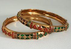 Flat red , green cabachons and red,green cubic zirconia stones studded Indian fashion Bangle set-12BANJ10  http://www.craftandjewel.com/servlet/the-1759/charm-bracelets-for-girls/Detail