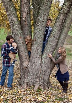 KIDS CLIMBING IN TREE AND PARENTS KISSING IN FRONT OR HUGGING.. FAMILY TREE!!