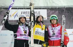 (L-R) Canada's Philippe Marquis (third place), Mikael Kingsbury (first place) and US Patrick Deneen (second place) celebrate on the podium after the Freestyle Ski World Cup Men's Moguls Test Event at the Snowboard and Freestyle Center in Rosa Khutor near the Black Sea resort of Sochi, on February 15, 2013.