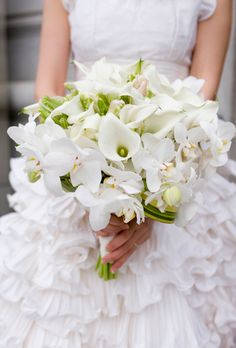 Brides.com: All-White Wedding Bouquets%0AAn exotic, textured bouquet made up of orchids, miniature calla lilies, and parrot tulips created by Hunt Littlefield, a San Francisco-based florist.Photo: Angie Silvy Photography