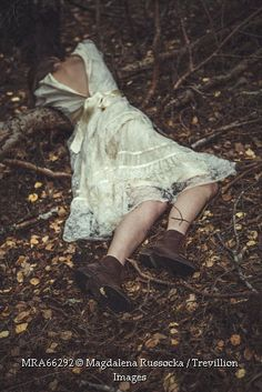 Trevillion Images - dead-historical-woman-lying-in-woods