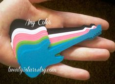 15 Electric Guitar Die Cuts in Any Color, Great for Cupcake Toppers or Scrapbooking. $2.50, via Etsy.