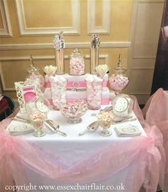 the table swags are the perfect touch to the displayed candies