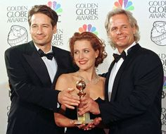 David, Gillian, and Chris with their Golden Globe for their work on the X-Files