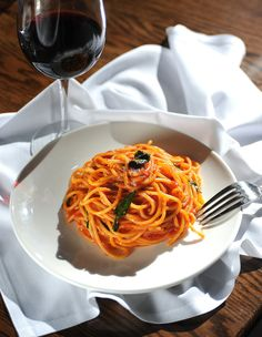 Spaghetti, with tomato, basil and olive oil, prepared by chef Brian Clevenger at Vendemmia. The relaxed setting includes a small, busy bar and an exposed kitchen. (Sy Bean / The Seattle Times)