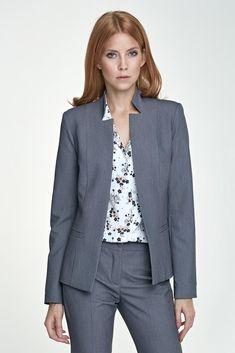 1cf483798e6a0 Avec sa coupe cintrée et ajustée, à la fois épurée et graphique, cette veste