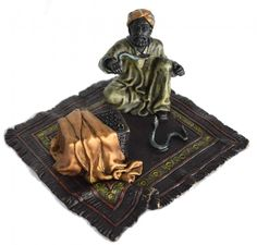 """Bergmann Vienna Bronze of a Snake Charmer. Vienna cold painted bronze of an oriental snake charmer on a carpet. Date stamp: Jug (Early 20th century) Dimensions: 3"""" H x W 5"""" 8 cm H x W 13.5 cm"""