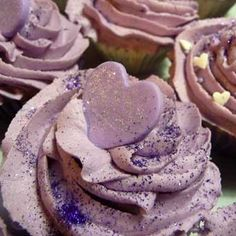 Purple Heart Cupcake @Evelyn Palacios I have some gum paste if you have anything we could use to cut out the shapes this would be GREAT!