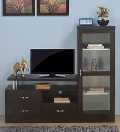 @home - is a perfect one-stop solution store for home planning with finest quality furniture, soft furnishings & home accessories that helps make life beautiful. The designs at @home are contemporary yet practical, reflecting Indian tastes & requirements. TV Stands are highly functional media units with open or closed storage for a clutter free look. Mount the TV onto the required panel or directly onto the wall and conceal all the cords behind. You can explore more tv stand online at… Tv Unit Furniture, Solid Wood Furniture, Wall Mounted Tv Unit, Tv Unit Online, Tv Entertainment Units, Buy Tv, Tv Unit Design, Coffee Colour, Quality Furniture