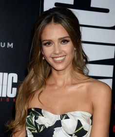 Jessica Alba looked beautiful and chic as she opted to dress up in a black strapless gown with white floral patterns printed all over and low cut neckline, which teased a hint of her petite cleavage and showed off her toned shoulders, while posing for the cameras on the red carpet at the premiere of her upcoming film Mechanic: Resurrection at ArcLight Hollywood on August 22, 2016 in Hollywood, Los Angeles.