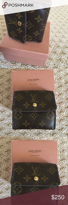 Authentic Louis Vuitton money wallet Louis Vuitton money wallet. In great condition. Has a section for coins and 6 credit cards and dollar bills. Non smoking home. Louis Vuitton Bags Wallets