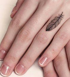 Feather finger tattoo for women