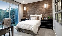 This Irvine, CA, bedroom boasts beautiful Haven pendant lights from @progressltg and stunning wood-look wall tile | Nash plan by Richmond American