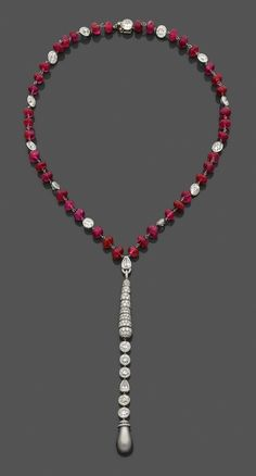 A ruby, diamond and platinum necklace set with a natural saltwater pearl weighing 42.97 grains