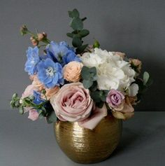 Low gold table centre from Jay Archer Floral Design