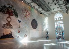 Studio Job's latest exhibition features giant stained glass windows and a roller disco.