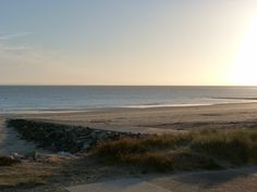 Sun goes down in Barneville Beach (la Manche 50 FRANCE) Jersey Island in Back