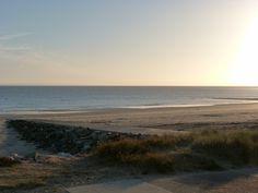 Sun goes down in Barneville Beach (la Manche 50 FRANCE) Jersey Island in Back