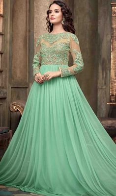 Embrace timeless elegance draping this mint green embroidered net floor length Anarkali suit. The stunning butta, lace, resham and stones work across the attire is awe-inspiring. #GorgeousFlaredFloorLongLengthAnarkali