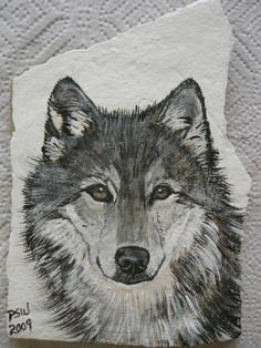 Timber wolf on stone/slate Stone Art Painting, Wolf Painting, Rock Painting Designs, Pebble Painting, Pebble Art, Painted Rock Animals, Hand Painted Rocks, Painted Stones, Tier Wolf