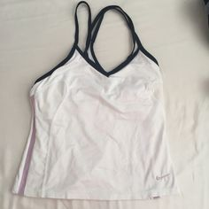 Nike super cute workout top Almost brand new - only worn once - perfect condition! No flaws, smoke free home. Dri-fit material, built in bra. Nike Tops Tank Tops