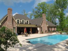 Unwind after a long day beside an inviting pool made even more special by a gorgeous brick patio. Get creative with your design for a look that's truly yours. http://insistonbrick.com/