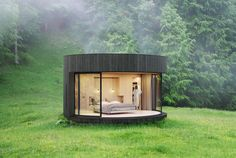 French-based Lumicene is using their signature curved glass window to create modern nature retreats. The Lumipod Prefab Cabin is a circular shelter. Its frame. Prefab Cabins, Prefabricated Houses, Wood Cladding Exterior, Bed Design, House Design, Glass Cabin, Charred Wood, Casas Containers, Double Vitrage